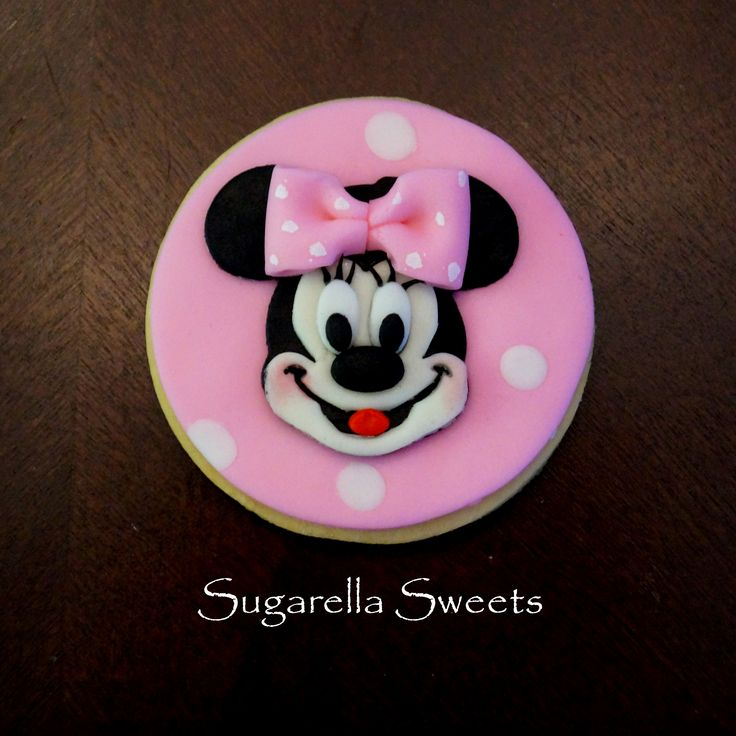 super cute minnie mouse cookie. Perfect to give away as a favor. www.SugarellaSweets.com