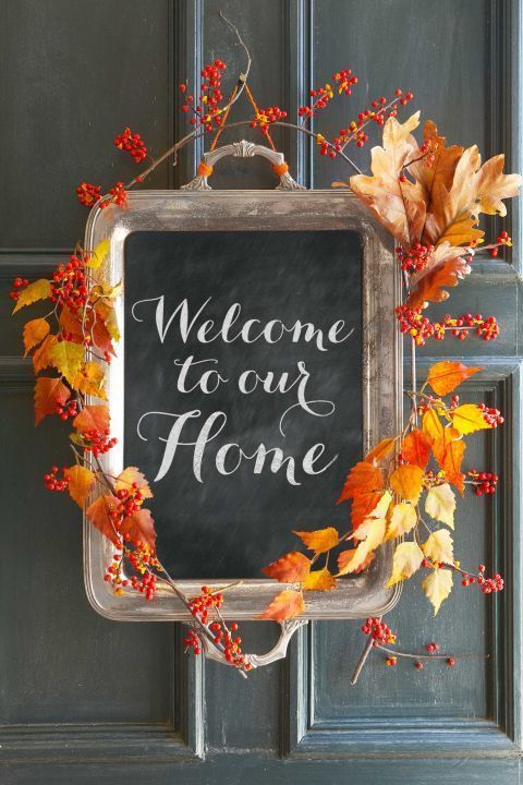 Door Greeting: Greet guests with this charming alternative to a fall wreath. Simply apply a layer of chalkboard paint to the inside of an old tray, then add autumn branches and bittersweet berries for a seasonal finish. Click through to find more DIY Thanksgiving decoration ideas for your home.