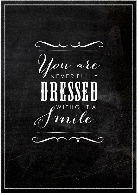 Black board print You are never fully dressed without a smile. Inspiring quoteTypography.