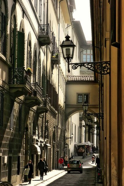 Firenze, Italy >>> Lungarno Archibugieri, Florence. Not so much a back alley (thank you Miriam), but still the sort of street where you might find that little hole-in-the-wall ristorante that serves the most superb seafood or pasta you ever tasted...