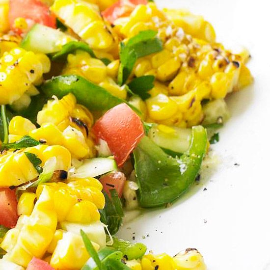 Fresh Corn Salad  Toss grilled corn with a variety of summer veggies and an easy marinade of cilantro, vinegar, and olive oil.