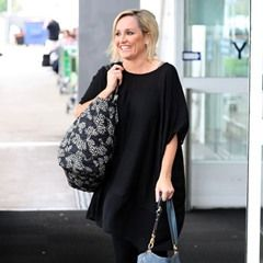 EXCLUSIVE Fifi Box all smiles as popular radio host flies back to Melbourne to join family for Christmas