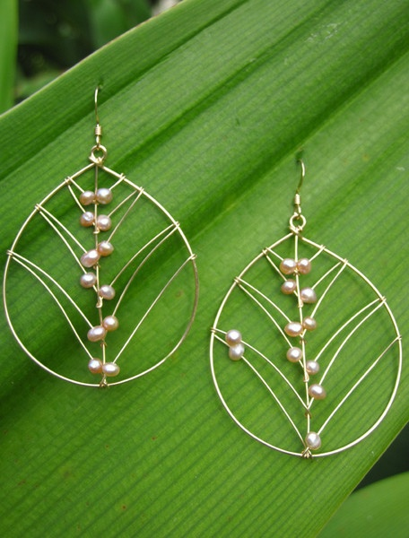 Pink freshwater pearls hand-woven into wire leaves-so delicate.