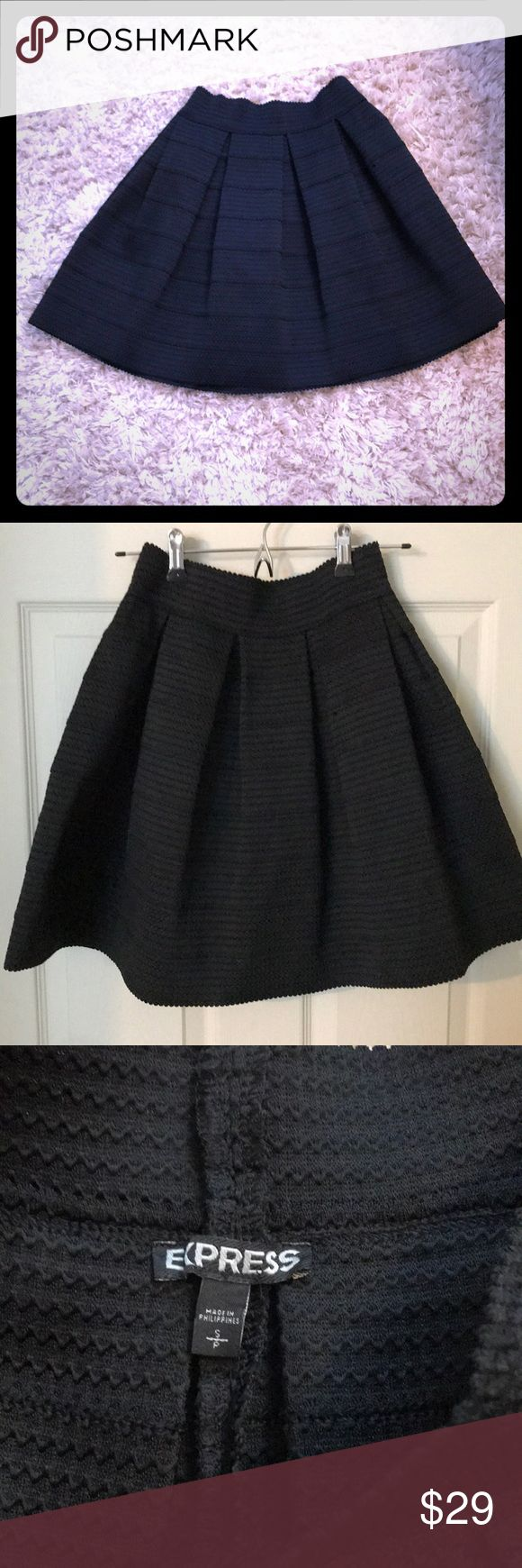 Black Express bandage skirt Black Express bandage skirt. Very slimming design! Size small. When on waist, skirt ends mid-thigh. Express Skirts A-Line or Full