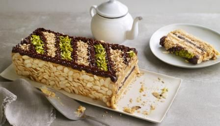 This cake combines layers of nutty meringue, praline buttercream and chocolate ganache. It's naturally gluten-free, too.   For this recipe you will need 2 x 30x20cm/12x8in Swiss roll tins, a freestanding electric mixer with a whisk attachment, a piping bag with a small star nozzle (no. 33) and a food processor.