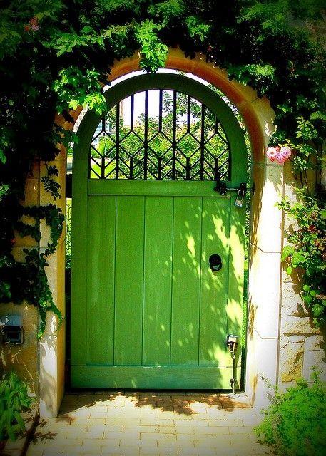 Stone wall, brick pathway, Climbing Roses, Green Garden Door- looks pretty inviting.