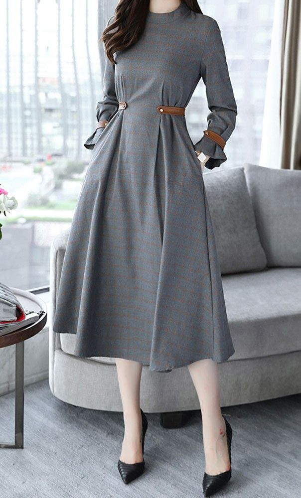 Tiffany is a classy mid length plaid dress with foldable vintage bubble sleeves and belted detail available in S-2XL
