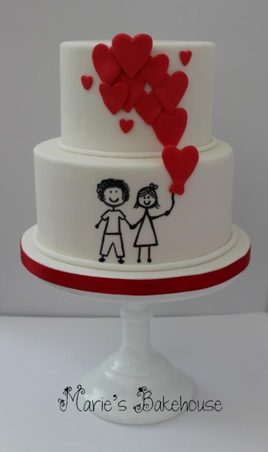Cartoon couple with heart balloons wedding cake