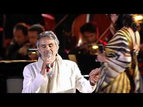 "Andrea Bocelli & Laura Pausini - ""VIVERE"" - YouTube Two great Italian performers, one classical, one pop, blending their voices together."