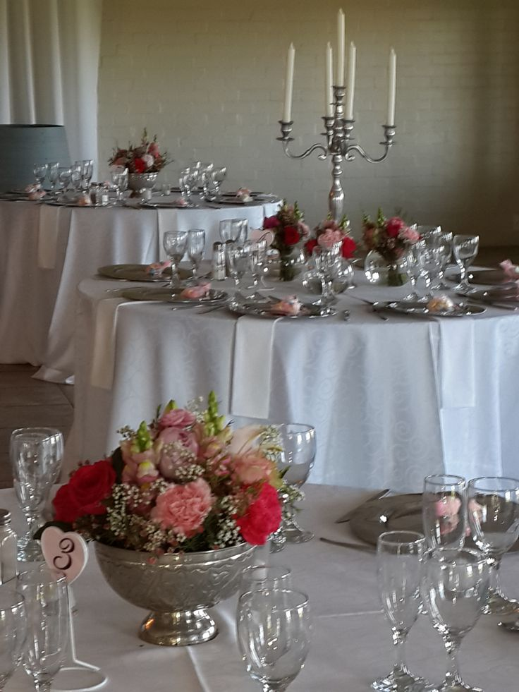 shades of pink with silver wedding center pieces