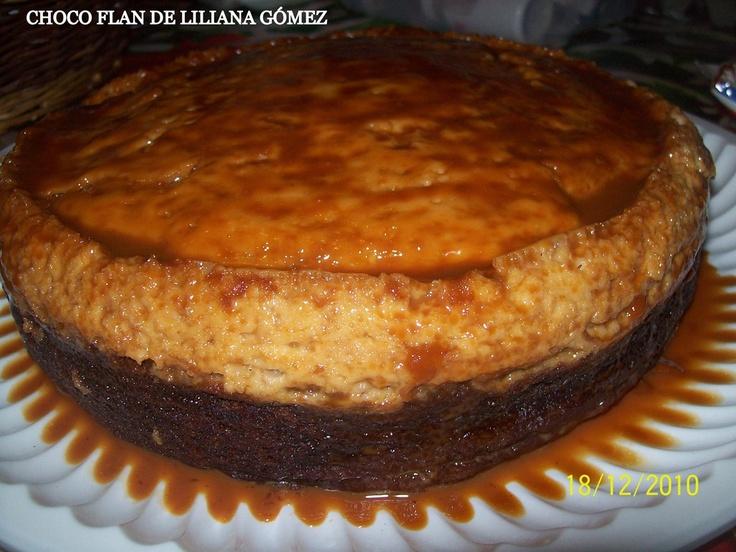 PASTEL IMPOSIBLE CHOCO FLAN PASTEL 2 cucharadas de mantequilla 1 taza de cajeta (300 g) La Cajeta es dulce de leche de cabra, puede ser quemada, envinada, o de vainilla 1 paquete de harina preparada para Pastel de chocolate (340 g) 3 huevos 1 taza de aceite (240 ml) 1 lata de Leche Evaporada (373ml) 1/2 taza de nuez, picada (50 g) EL FLAN 1 lata de Leche Condensada azucarada (397 g) 1 lata de Leche Evaporada (373ml) 5 huevos 1 cucharadita de esencia de extracto de vainilla