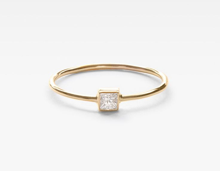Our square diamond stacking ring is the perfect balance of simplicity and edge. Featuring a .10ct white square diamond, bezel-set on a 14k gold band, this ring is easy to wear everyday and fun to stack with others. If you need help with sizing, please visit our sizing chart or order our physical ring sizer for exact results.  •...