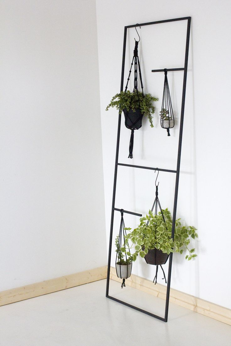 A versatile hand welded steel display ladder for plants, bathroom linens,  or kitchen pots and accessories. Dimensions: x with a thick steel frame  These ...