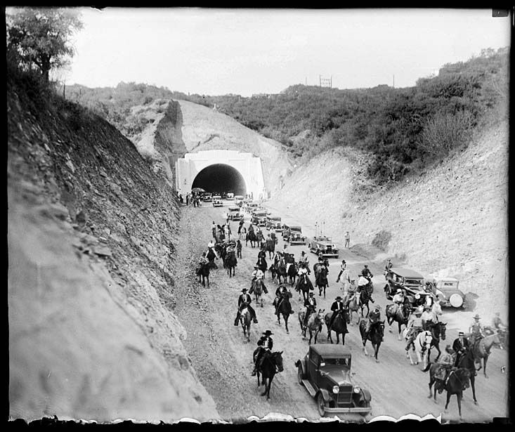 Following the opening ceremonies, a procession of cars, horses and wagons proceeds south through the new Sepulveda Boulevard tunnel (September 27, 1930). After eight years of construction, the new tunnel connected the San Fernando Valley with West Los Angeles.