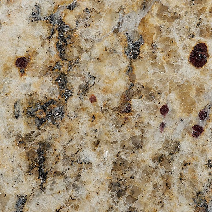 Santa Celia Granite close up. Chunky burgundy colored garnets decorate this stone. Once installed, it will look hot!