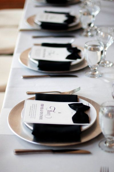 Black bow ties and napkins add formality to these wedding menus. Plus, they just look cool!