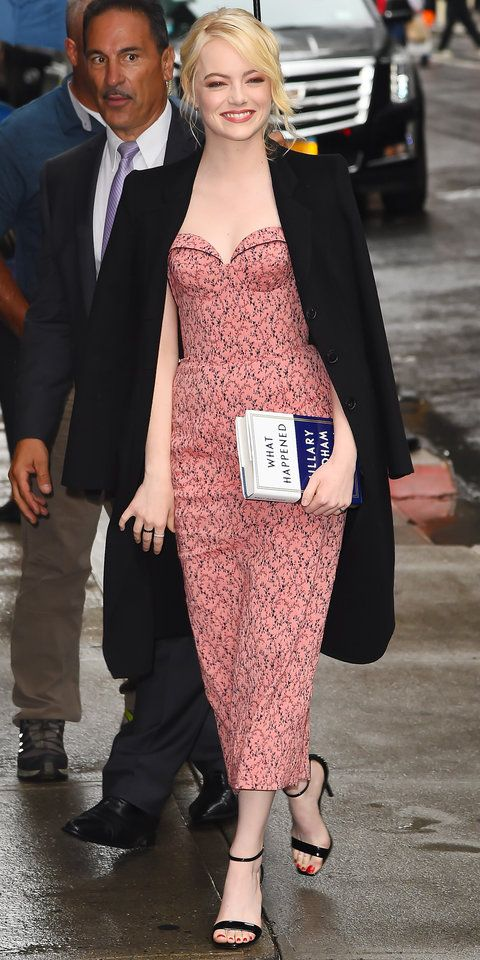 Despite the rain, Emma Stone was as chic as ever heading to The Late Show with Stephen Colbert. The actress paired her pink and black dress with strappy heels and a classic menswear-inspired coat.
