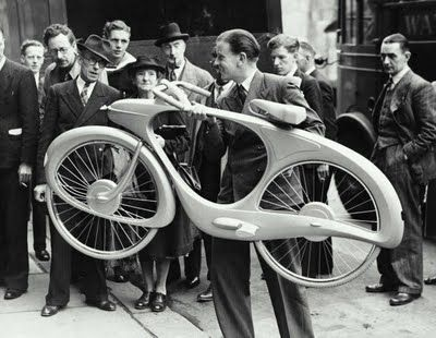 "British born Benjamin Bowden originally designed the futurist Spacelander bicycle for the ""Britain Can Make It"" exhibition in 1946. Conceived in aluminum, the dynamic form featured a direct drive hub dynamo that stored the downhill energy and released it on uphill runs."