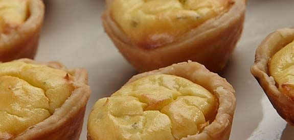 Caramelized Onion-Cheese Tarts; Swap pie crust for phyllo shells, 1 tbsp evoo;1 tbsp butter;1 c ch onions;1 tbsp sugar; 4 oz feta; 1 lg egg, 2 tbsp ff l/2 & l/2;  sprinkle thyme! Carmelize onions, 1 tbsp in pastry cup; mix all other ingred, pour on onions. 375 for 15-20. serve.