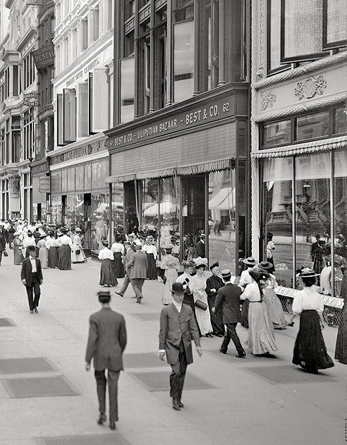 """A great street scene view of New York City during America's Gilded Age era, c.1905. Pedestrians and shoppers walking aside storefronts, including; Best and Company - Lilliputian Bazaar, which was originally a childen's clothing store, founded in c.1879. Formerly located in the """"Ladies Mile"""" near, 6th Ave, & West 23rd, St., NYC. ~ {cwlyons} ~ (Image: librar-y tumblr)"""