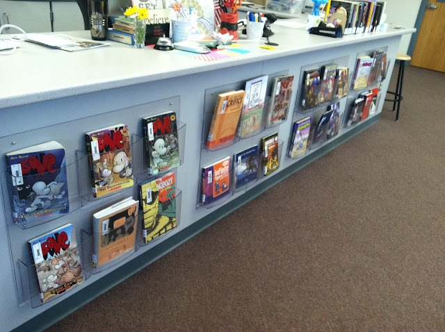 acrylic book displays attached to circ desk - could be used for brochures too.