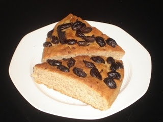 This is a bit different from the Olive Bread that we posted previously, in that it is a lot flatter and the olives are on top rather than inside. It's a lovely accompaniment for a meal and especially to dip in your salad with olive oil!