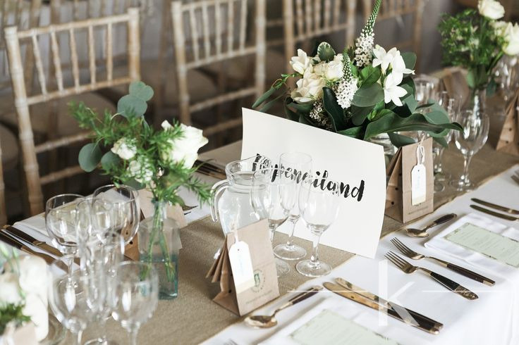 Strong foliage and simple white flower tablescape
