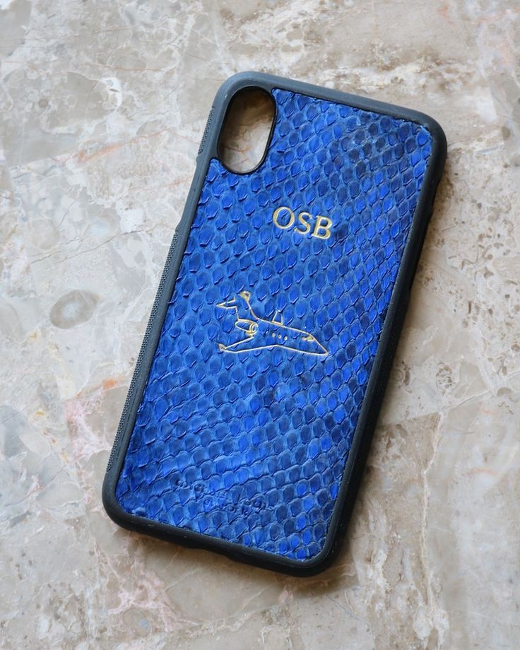 iPhone X Case style in Blue Python 'Snakeskin'   Personalized with 'OSB' and Plane '🛩' Emoji in Gold Foil.   Personalize your own, https://michaellouis.com/collections/leather-iphone-x-cases