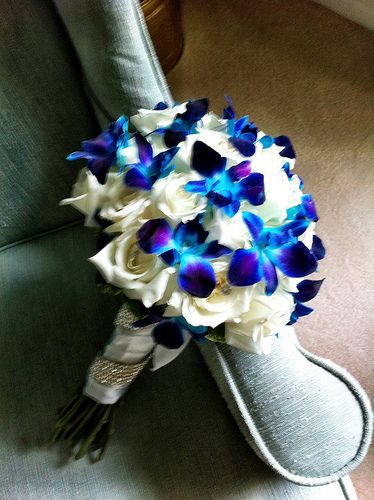 Bouquet of white roses and blue-green dendrobium orchids wedding by Floralsbysharon