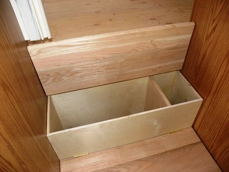 Hidden storage inside stairs!  Stair tread flips up with concealed hinge to reveal storage underneath!  Genius...