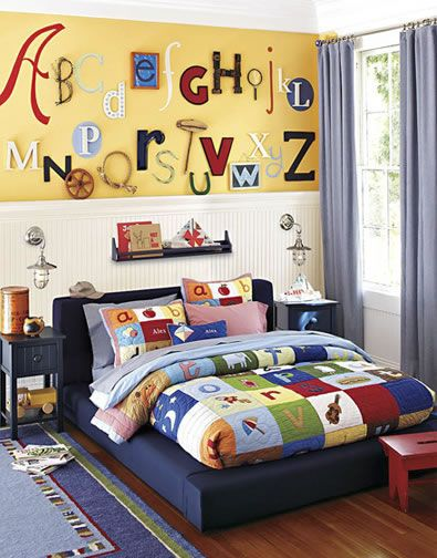 Boys Bedroom 29 Here we mounted a three-dimensional mural made from letters in different sizes and colors – a perfect complement for a quilt that features alphabet appliqués. The covers of favorite books echo the reading theme on the shelf mounted over the bed. A platform bed makes this room perfect for kids of all ages.