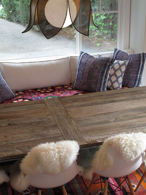 home-built banquette (hint: it starts with unfinished kitchen cabinets). Love use ions and rugs