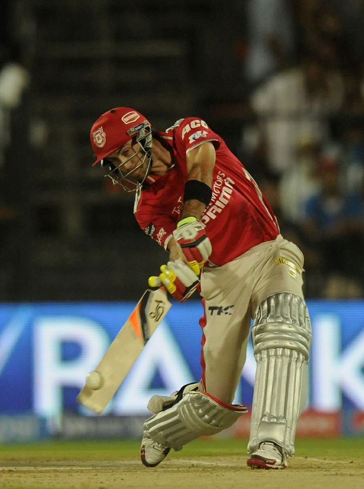 Glenn Maxwell steps out for a big hit, Kings XI Punjab v Sunrisers Hyderabad, IPL 2014, Sharjah, April 22, 2014