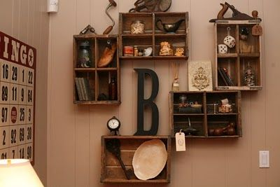 hanging crates on wall for a shelf   She used them as shelves, inspired by Pottery Barn: