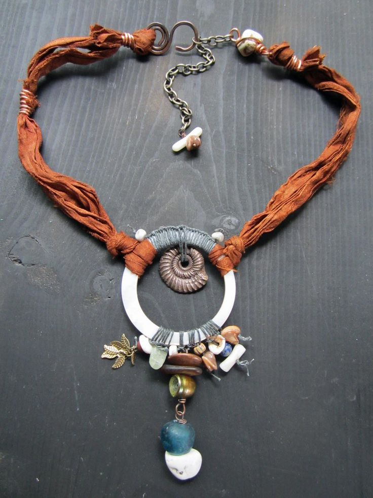 Necklace   Staci Louise Originals.  shell donut, african trade glass, sea glass, shell beads, recycled sari silk, a bronze ammonite bead, handmade clasp.