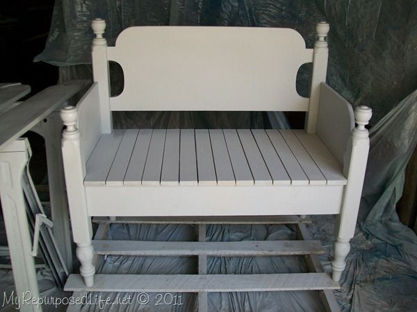 Sweet... I have a twin headboard in the garage just like this!  Headboard bench!
