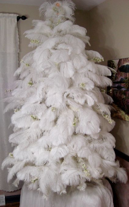 Ostrich Feather Christmas Tree, This tree is covered in fluffy white ostrich feathers. The angel is handmade. I made it look like it was par...