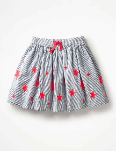 We took the best stars from the night sky and sewed them onto this stripy skirt, so it'll shine through the day. At the waistband there's a colour pop grosgrain tie, and elastic at the back for a great fit. This 100% cotton design is fully lined to keep things comfortable for all-day fun.
