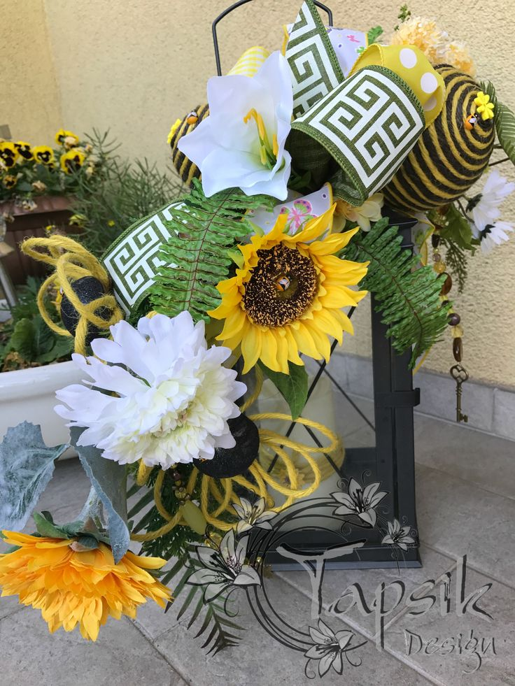Summer Sunflower Lantern Swag. Great decoration for summer. On your balcony, porch, garden. Made out of different kinds of flowers and greenery, handmade twine flowers and balls, handmade bead garland and of course a bow made out of 4 different kinds of ribbon. The lantern is about 45 cm tall (18 inch). And inside a LED candle with timer, i have decorated the candle so called summerly as well.