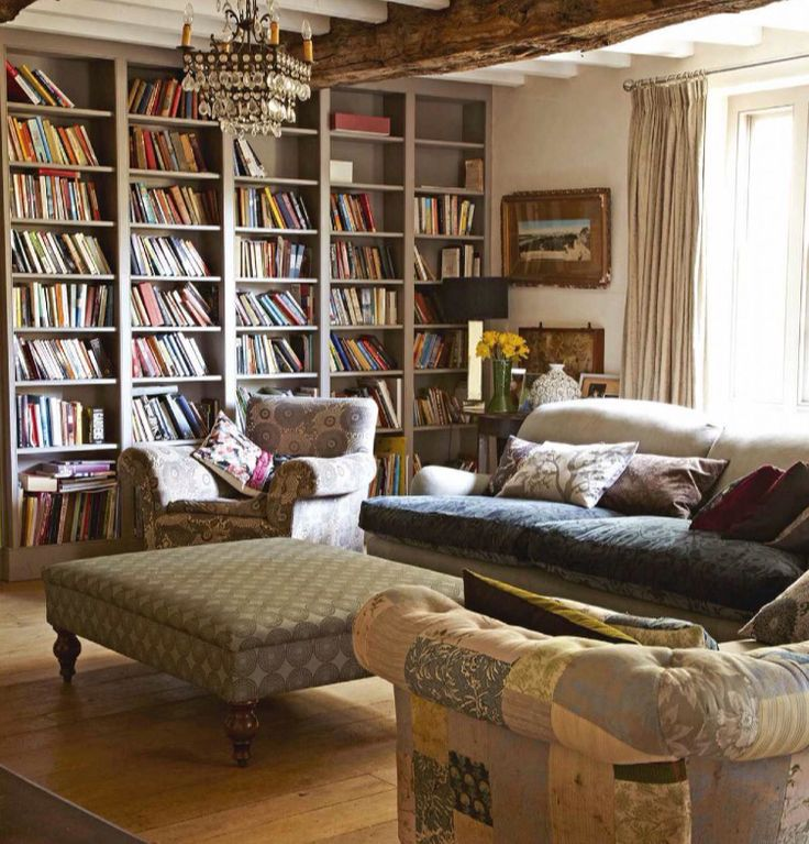Bookcases in Farrow & Ball's Charleston Gray and love the chandelier. #paintcolors #upstatehouse #countryhouse #livingroom photo from Homes & Antiques