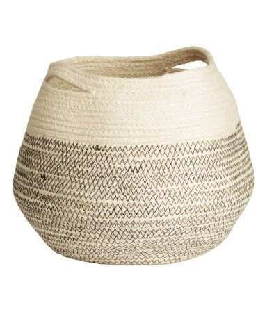 Natural white. Small storage basket in jute with two handles. Diameter approx. 8 1/4 in., height 9 in.