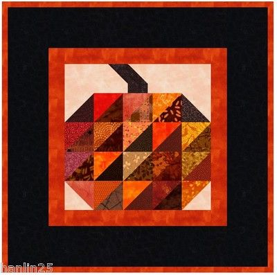 Halloween Pumpkin Quilt wall hanging kit seen at eBay. Simple half-square triangles with a stem
