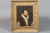 """A late 18th Century Continental School, oil on canvas, a head  and shoulder portrait of a 17th Century merchant wearing a jewel  on a black hat, white ruff and jewelled waistcoat, within a 19th  Century foliate scroll and egg and dart moulded frame, unsigned,  13.75""""h x 10.75""""w SOLD FOR £1950"""