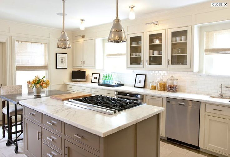 Eventually make kitchen look like this! Marble countertops, white subway tile, glass cabinets to see white dishes