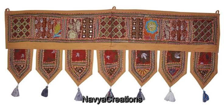 A fancy door toran that attracts & welcomes! This beautiful handmade toran is one of the finest Indian wall hangings that you can now online order at very reasonable price. Color combination is just perfect to attract any eye plus at the end of each decorative line it holds beautiful small tassels that make this toran overall amazing.