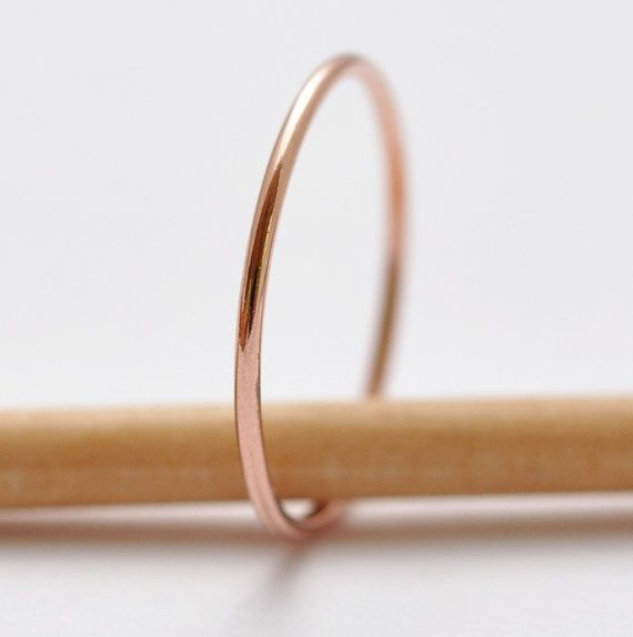 I really like the thinness of this band. Rose Gold Simple Wedding Rings 14K Jewelry by BlueRidgeNotions