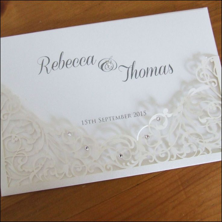 This filigree laser cut wedding invitation is finished with crystals.