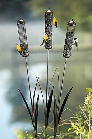 Cattail wire mesh bird feeder stakes for chickadees, nuthatches, and finches.