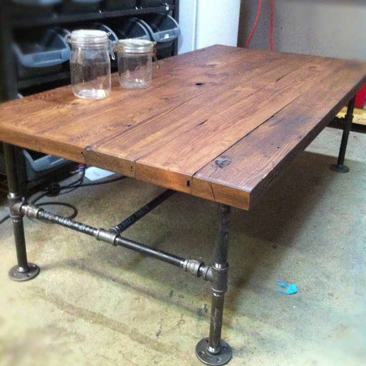 weekend project inspired by barn wood cast iron pipe coffee table by on etsyexactly the style i want for a dining room table