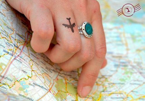 Plane tattoo on finger